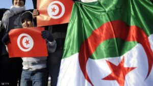 People hold Tunisian and Algerian flags on January 22, 2011 in Marseille, southern France, in support of local pro-democracy demonstrations in Algeria. The Algerian League for the Defence of Human Rights (LADDH) said today the blanket government ban on peaceful protest could cause a social explosion in the North African country, eight days after ousted leader Zine El Abidine Ben Ali fled Tunisia following violent street protests. AFP PHOTO / ANNE-CHRISTINE POUJOULAT (Photo credit should read ANNE-CHRISTINE POUJOULAT/AFP/Getty Images)