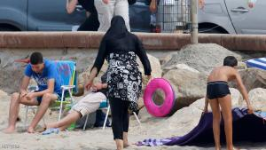 A Muslim woman wears a burkini, a swimsuit that leaves only the face, hands and feet exposed, on a beach in Marseille, France, August 17, 2016.    REUTERS/Stringer
