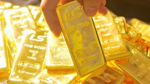 Pure 1,000-gram gold bars produced by South Korea's LS-Nikko are stacked in a dealers room in Seoul on January 9, 2009. Gold prices have soared on strong demand due to the local currency's sharp depreciation against the US dollar last year.  AFP PHOTO/KIM JAE-HWAN (Photo credit should read KIM JAE-HWAN/AFP/Getty Images)