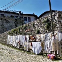 Berat, Albania – March 25, 2016: Hanging clothes in an old street in Berat, Albania.