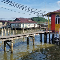 Kampong Ayer, Brunei – July 17, 2015: Footbridges over the water in Kampong Ayer, a historic settlement area in Bandar Seri Begawan made of a cluster of traditional stilt villages built on the Brunei River.