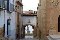 An arch in a street in La Iglesuela del Cid