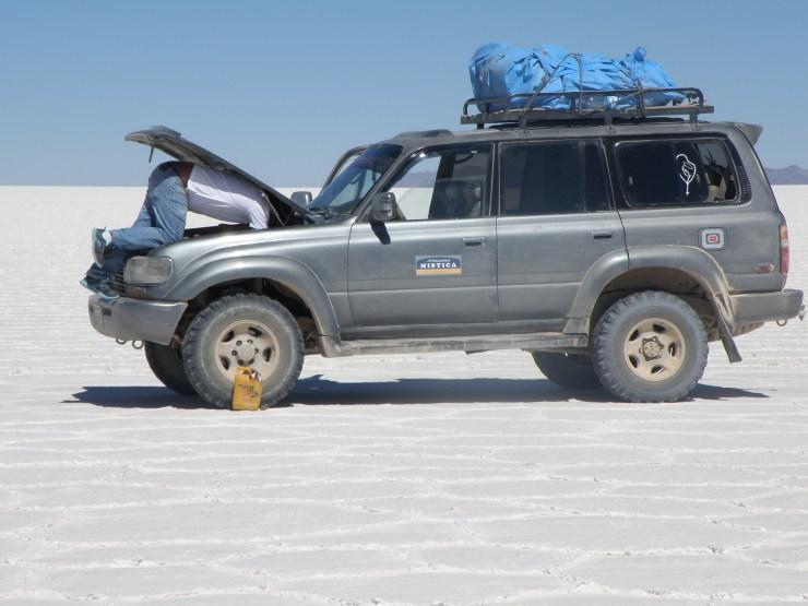 Fixing a car in Uyuni Salar, Bolivia