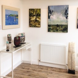 Paintings by Andrew Tozer (left) and Jon Doran (right) with ceramic sculpture by Peter Hayes