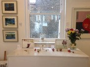 Paintings by Richard Tuff (left), Nancy Crewe (middle) and Emma Dunbar (right) with ceramics by Remon Jephcott