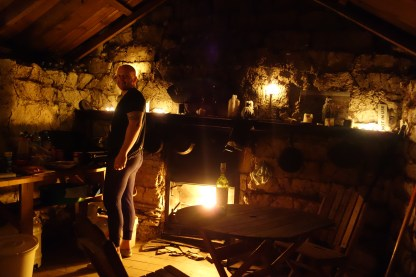 New Zealand: Cooking by candlelight in the mud hut.
