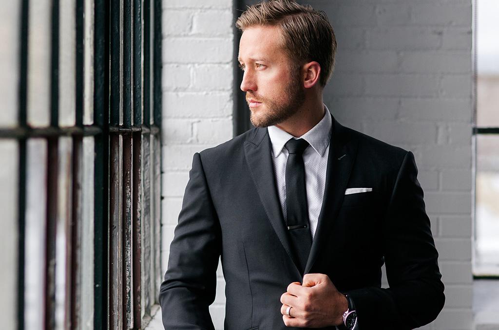pick stitching on a black custom suit lapel
