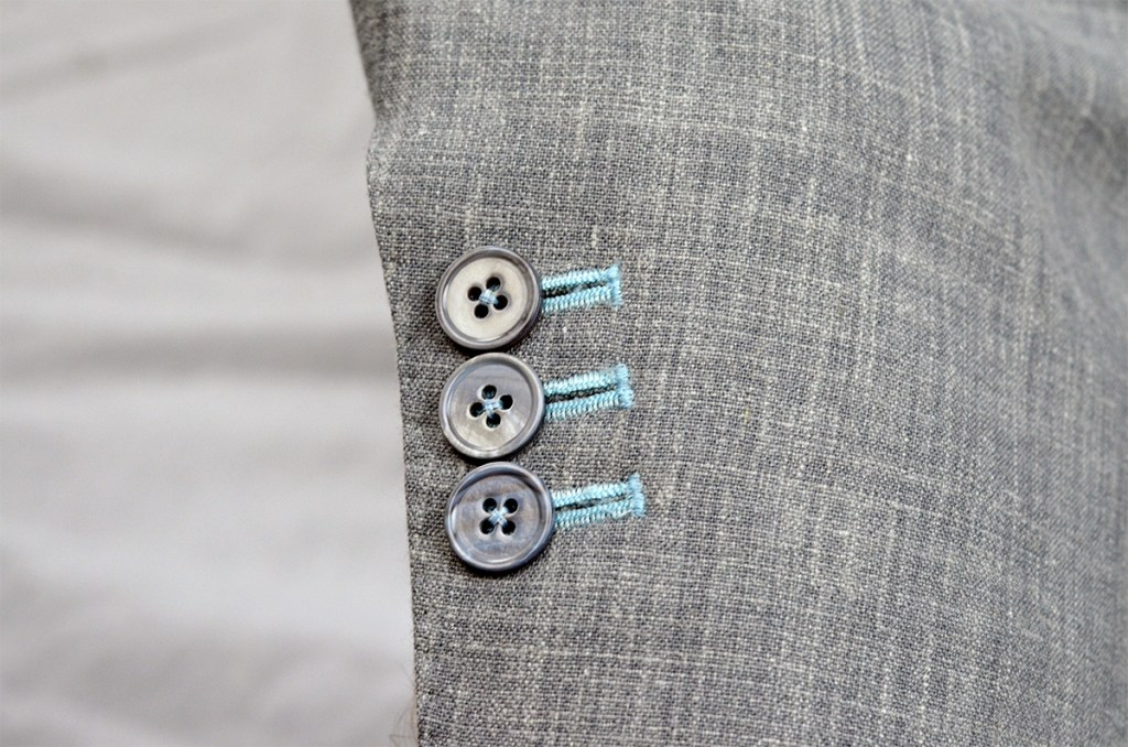 working button holes on a jacket sleeve