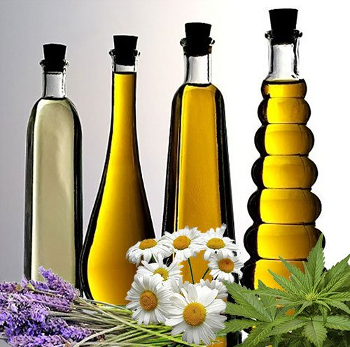 Best vaporizers for herbs and essential oils - 4 bottles of oil with daisies, lavender and cannabis leaves