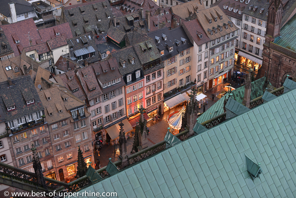 View over the roofs of the Cathedral of Strasbourg down to the square and Christmas market