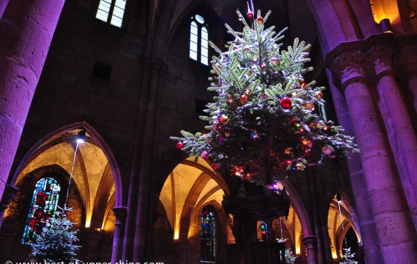 Christmas tree decorated with paper flowers.