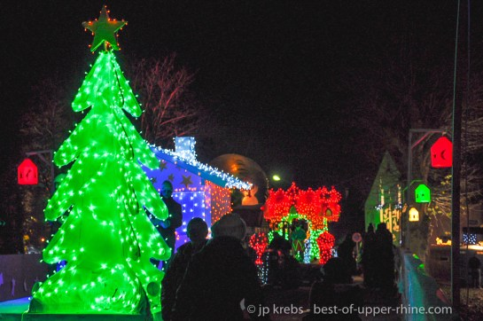Christmas Trails in Osthouse Alsace 2012. Colorful Christmas Lights parade …