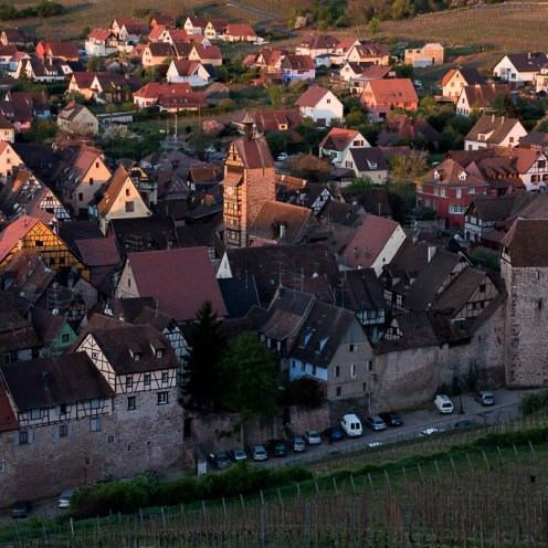 The morning sun highlights the medieval Dolder tower of Riquewihr, Alsace