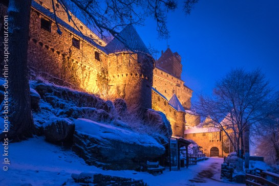 The Haut-Koenigsbourg castle in Alsace, shines in the dark.