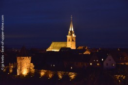 Church of Bergheim at night and ramparts.