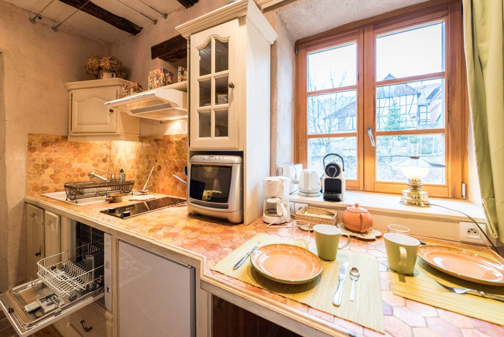 The kitchen place of The Gobelin's romantic Studio, charming studio with great comfort and Large double bed in Riquewihr for 2 persons