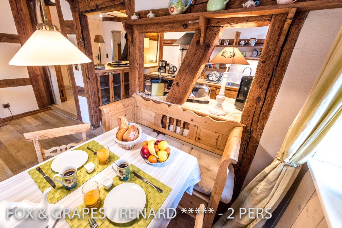 The dining room and kitchen of the Fox & Grapes, romantic and charming apartment for 2 adults is located in the medieval heart of Riquewihr in Alsace