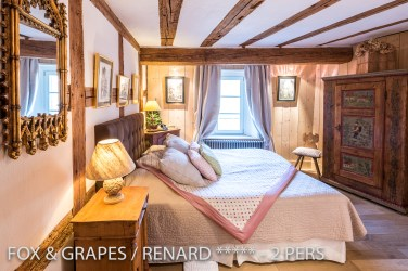 The bedroom of the Fox & Grapes, romantic and charming apartment for 2 adults is located in the medieval heart of Riquewihr in Alsace