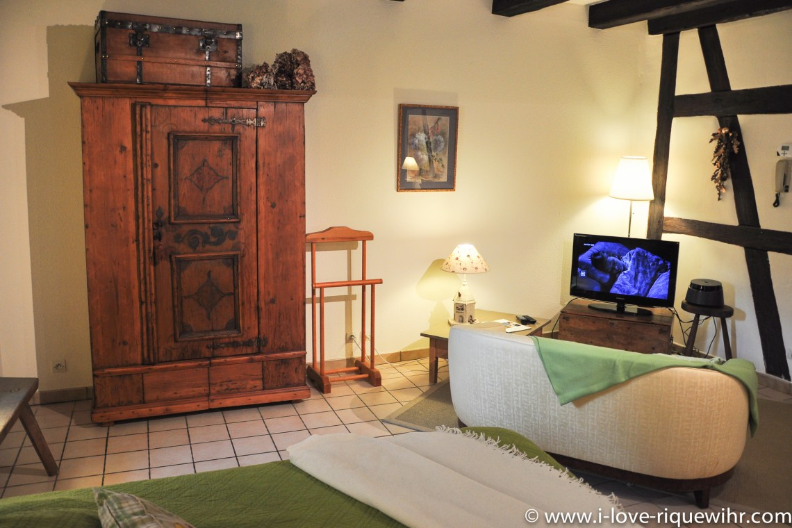 The main room of Sylvaner, charming holiday apartment for 2 persons in Riquewihr is decorated with old traditional Alsatian cabinet