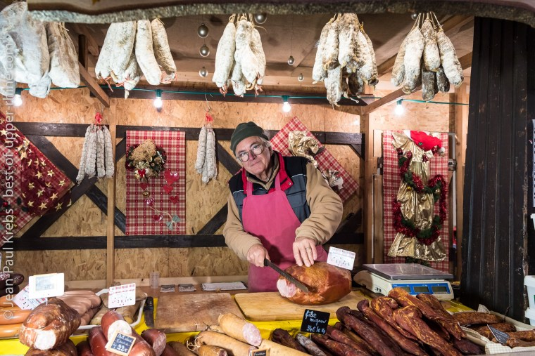 Hams and sausages, local products at the Christmas market of Koïfhus in Colmar.