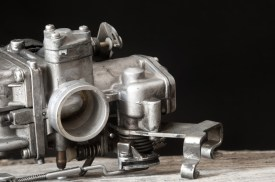 motorcycle carburettor on a work bench