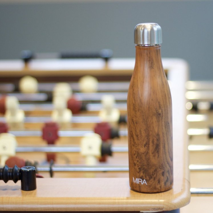 The Mira bottle stadig on a fussball table