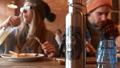 a picture of folks sitting next to the best travel water bottle