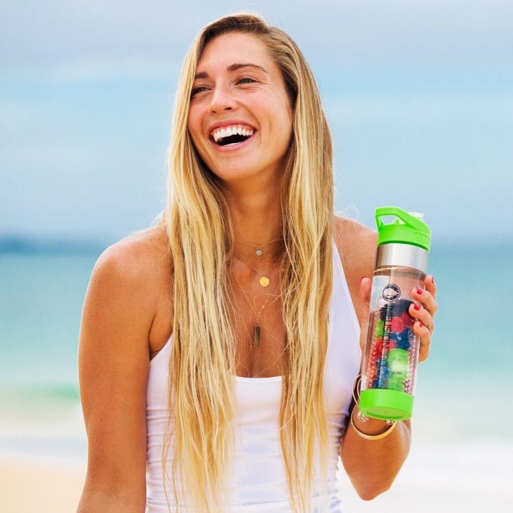 girl holding an Infusion Pro Premium bottle