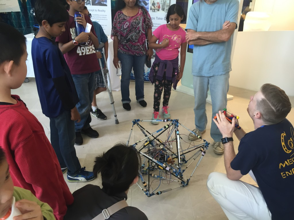 BEST Labber Drew Sabelhaus explains a tensegrity robot to attendees of the 2016 Robot Block Party