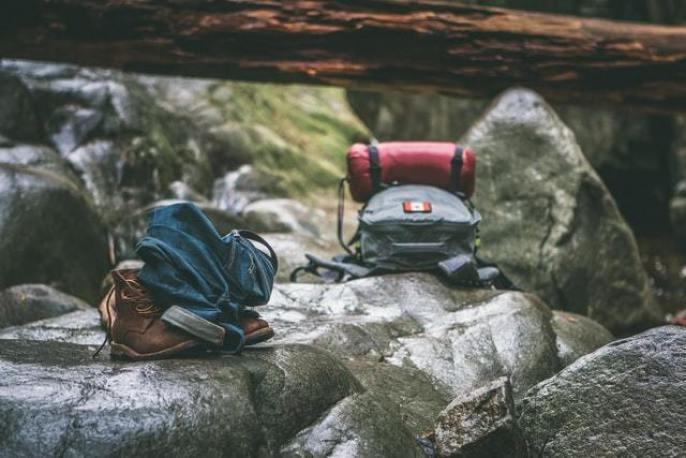 two backpacks sitting on a mountain