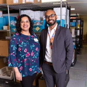 Nahid Alam and Adrian William in the central supply room at Providence Healthcare.