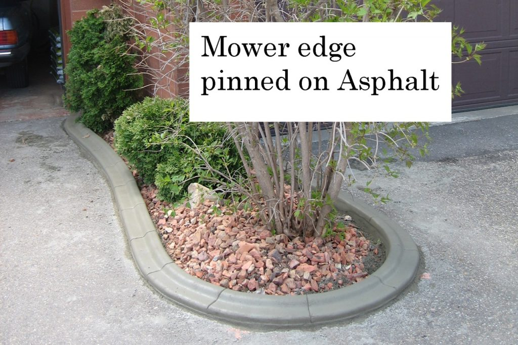 mower edge curb Pinned on asphalt