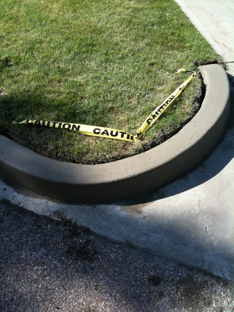 Our repair done to  curb