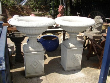 Large Grecian Urns on Diamond Plinths