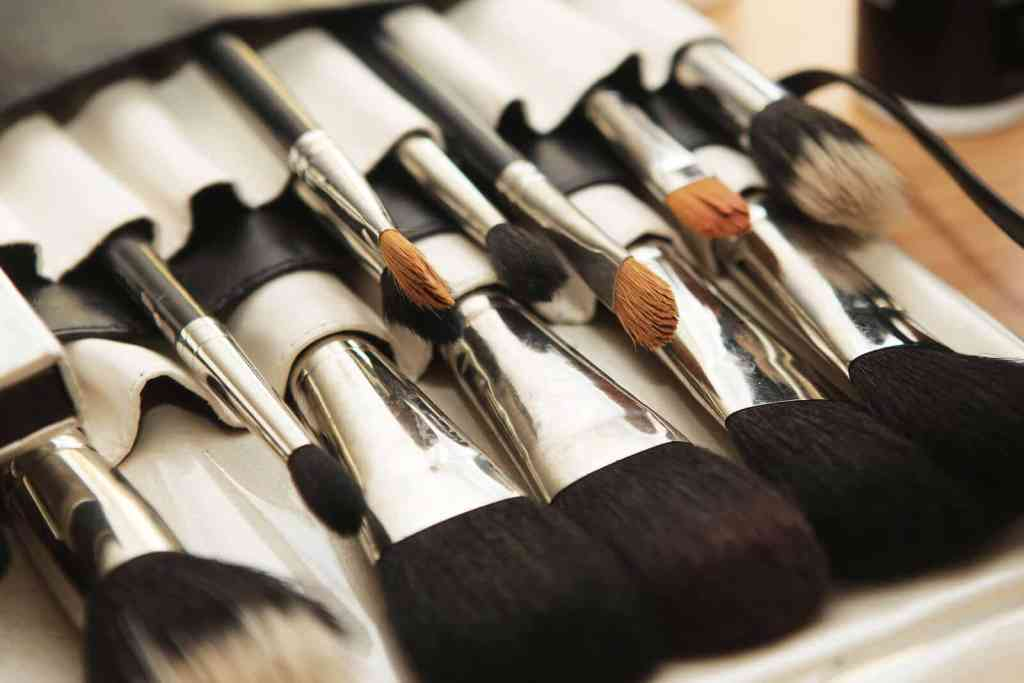 Closeup of makeup brushes in their holder