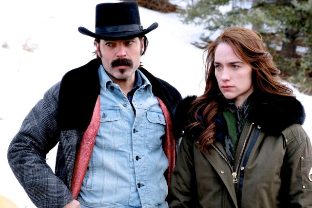 "WYNONNA EARP -- ""No Cure For Crazy"" Episode 304 -- Pictured: (l-r) Tim Rozon as Doc Holliday, Melanie Scrofano as Wynonna Earp -- (Photo by: Michelle Faye/Wynonna Earp Productions, Inc./Syfy)"