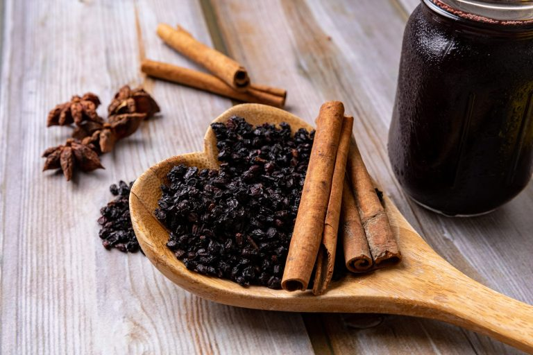 elderberry and cinnamon on a table top