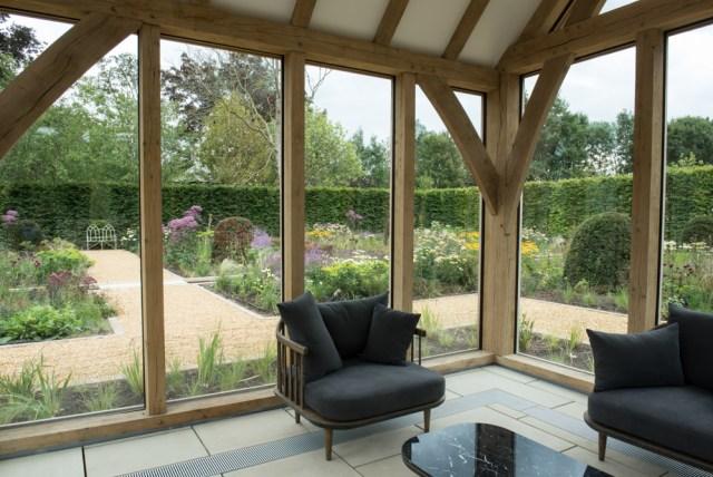 Inside the glass house in the flower garden. Garden and glass house designed by: Anoushka Feiler