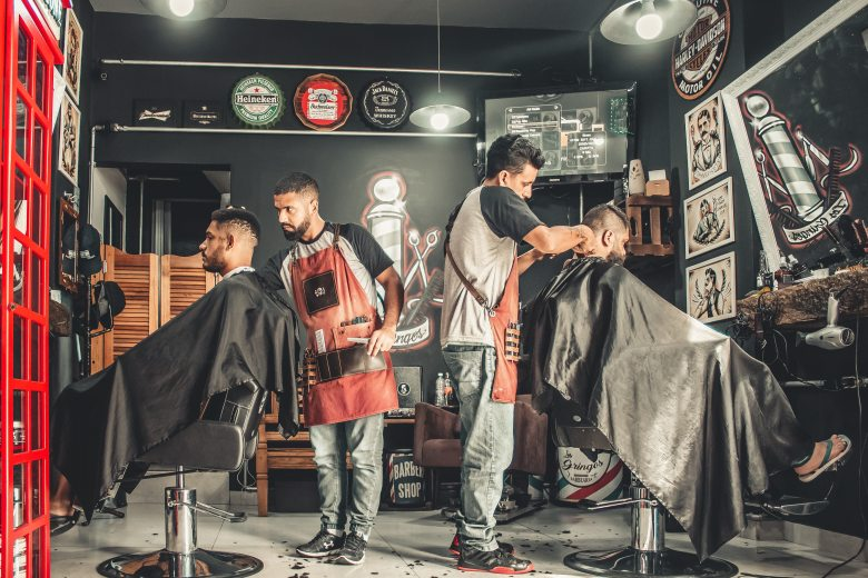 men-having-their-haircut-1813272