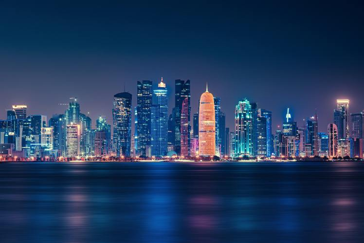 body-of-water-across-city-buildings-during-nighttime-3069345