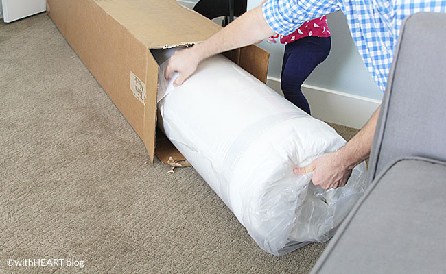 mattress rolled up in a box