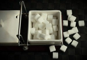 Sugar cubes on the black table
