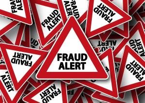 Signs saying fraud alert