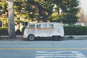A rusty van on the street