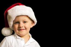 A kid with a Santa hat Christmas in Florida