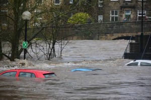 Car submerged on a flooded street.