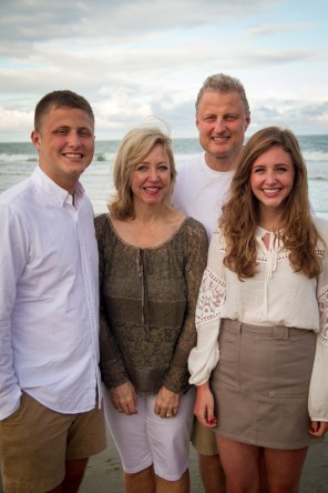 Classy family portraits on the beach in winter