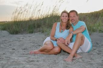 Couple posing for beach portraits