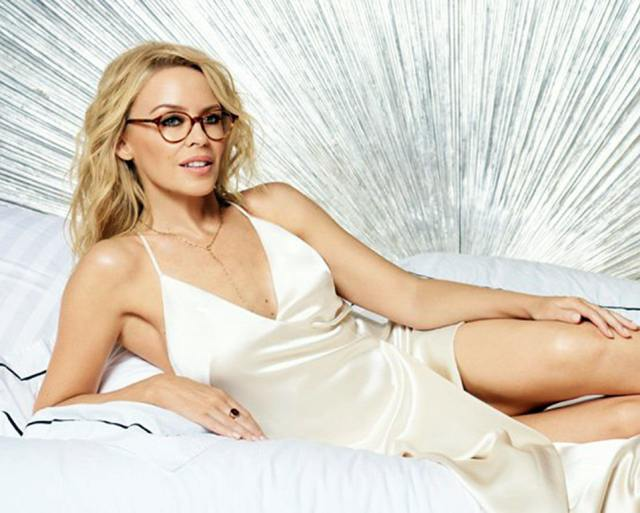 Kylie Minogue on Bed