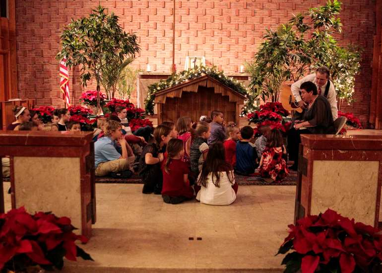The children in attendence come up to the alter to hear a Christmas story and recieve candy canes. St. Francis X Cabrini holds what may be the final service at St. Francis on Christmas Eve, Dec. 24, 2015. Wicked Local Staff Photo/Alyssa Stone